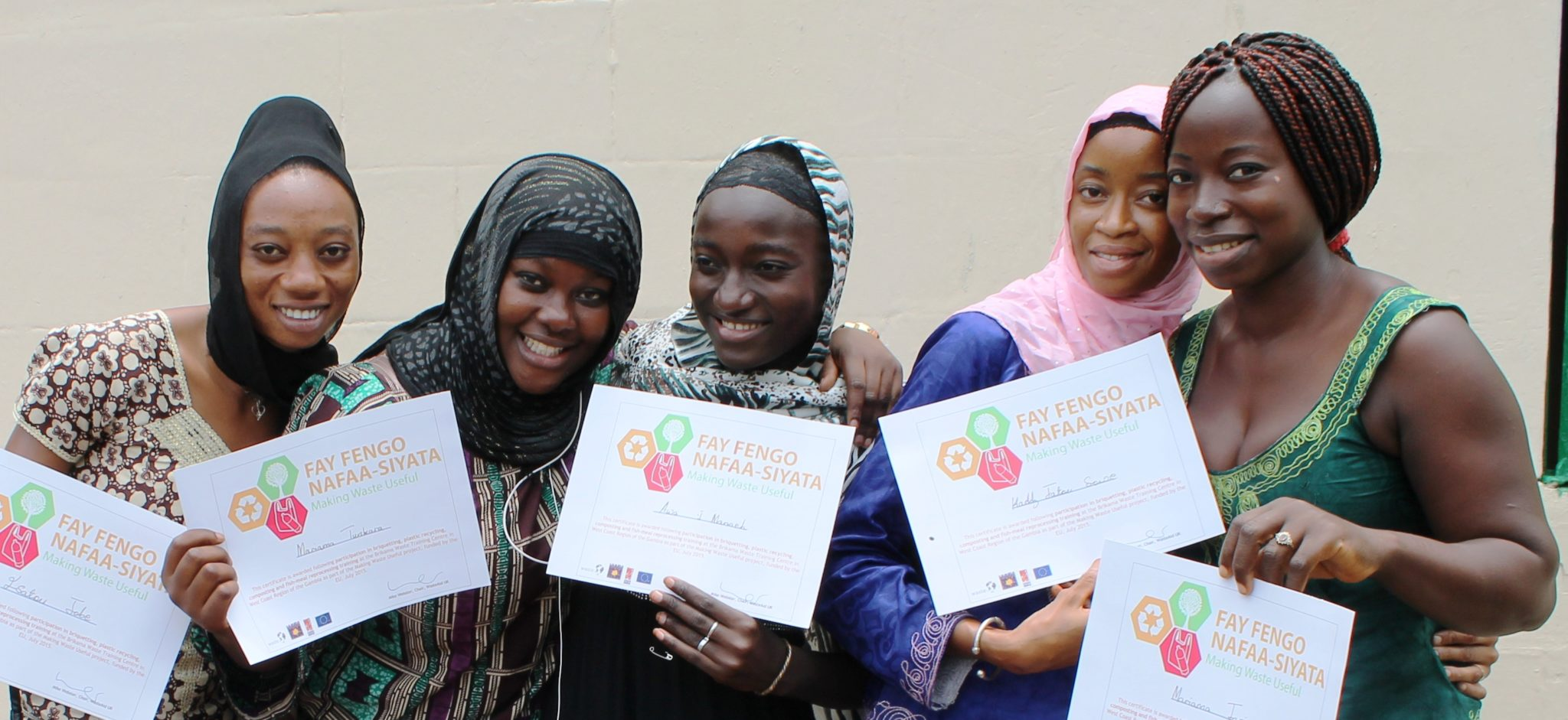 Members of Women's Initiative The Gambia after learning waste and recycling skills