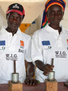 WasteAid UK trainees learning to make charcoal briquettes from organic waste