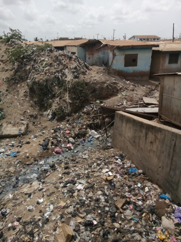 Waste dumped by households is readily washed into drainage channels when the heavy rains come (Accra, 2016)