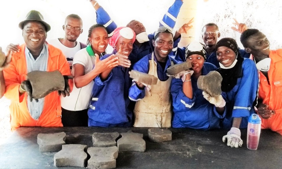 Pierre Kamsouloum (centre) taught how to make paving tiles from plastic bags