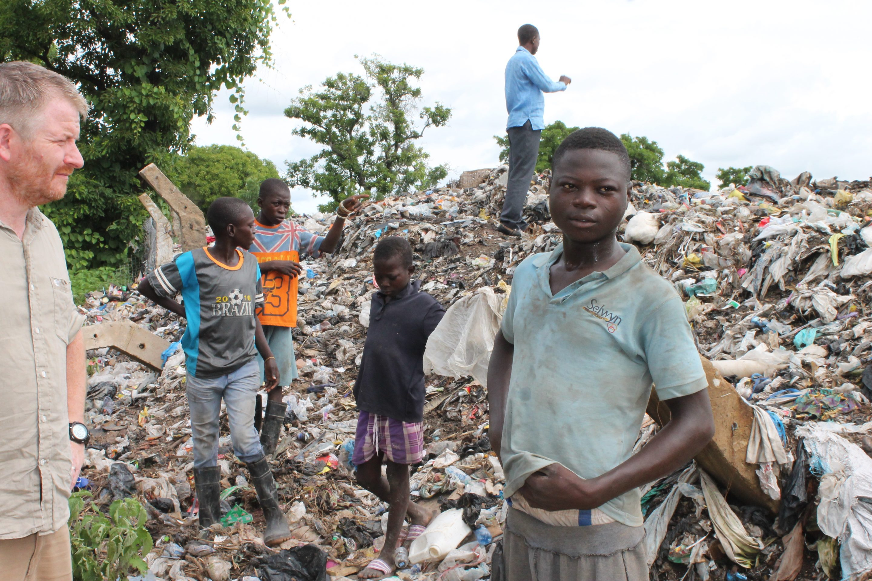 Local people pick through the waste for materials they can sell