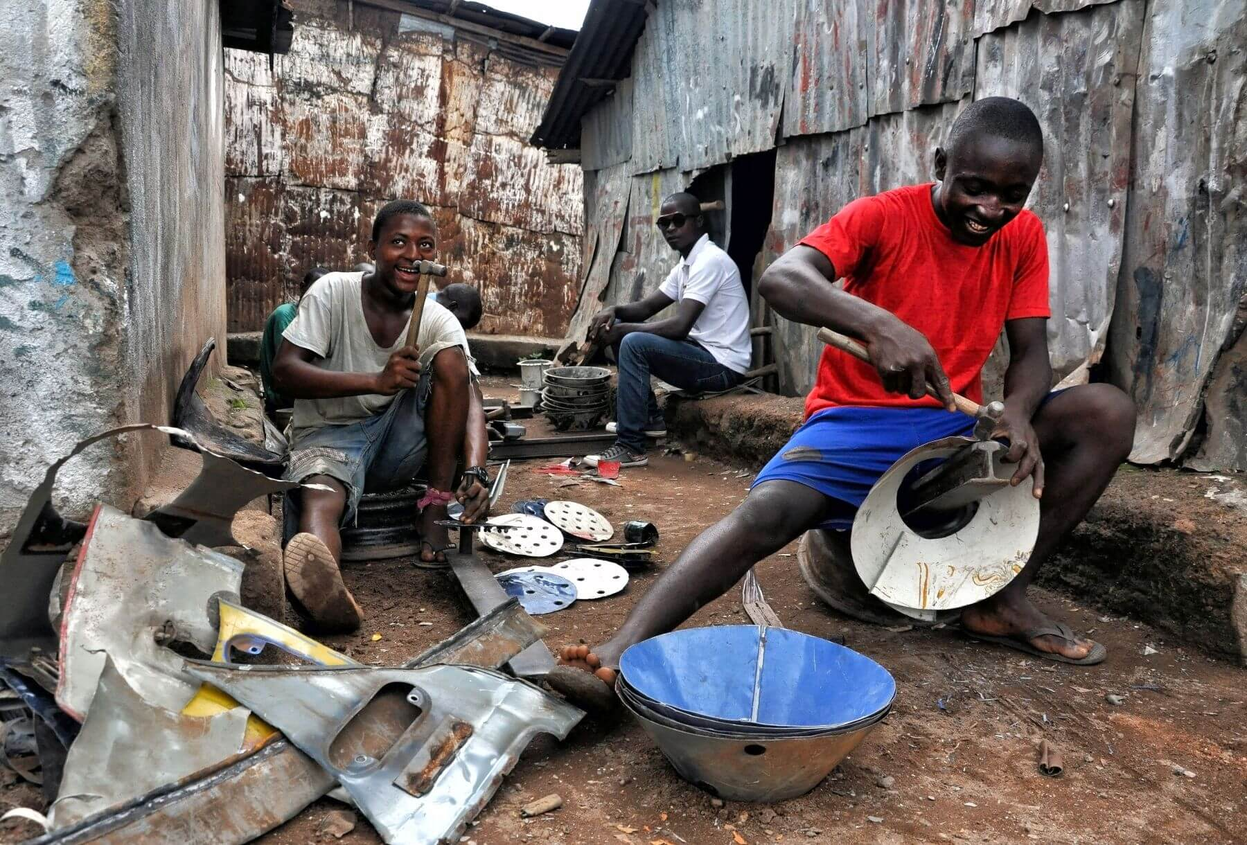 Metal recycling apprentices, by Saula Cordova in Makeni, Sierra Leone (1st place winner)