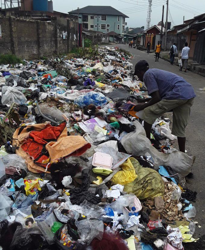 People scavenge through dumped waste in Uyo, Nigeria (photo: Camillius Ekujere)