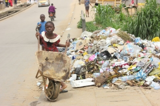 With no waste collection service, people have to dump or burn their waste