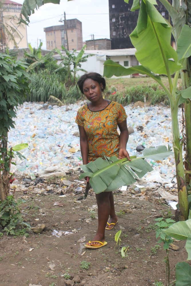 Life carries on alongside rivers flowing with plastic waste, in Douala, Cameroon