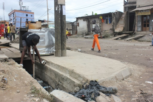 Drainage channels are easily blocked with plastic waste in Douala, Cameroon