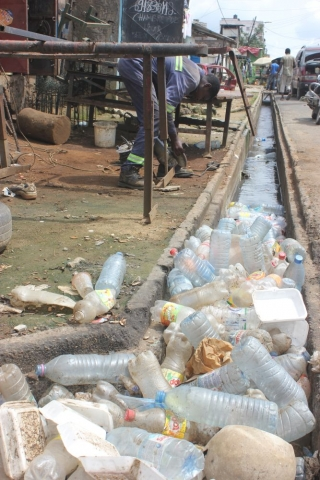 Drains full of plastic waste are commonplace in Douala, Cameroon