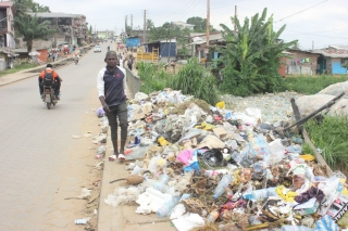 Plastic waste accumulates at the roadside in Douala, Cameroon