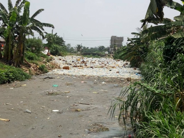 A tide of plastic flows downstream in Douala, Cameroon