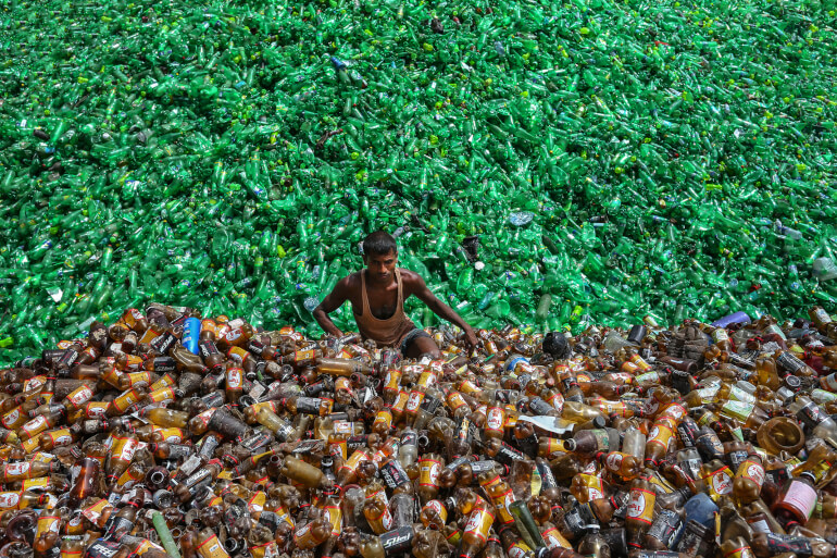 A plastic recycling factory worker in Bangladesh by Mohammed Rubel