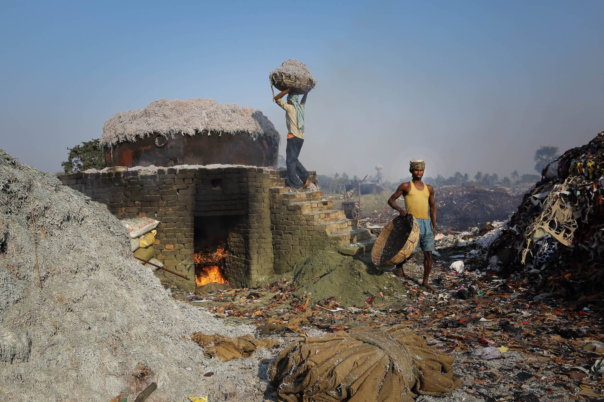 Fertiliser is manufactured from the waste of the leather-making process in Kolkata, India. At night a long low flame will turn this leather waste into fertiliser, enabling it to be used for agriculture at a very low cost, by Sandipani Chattopadhyay