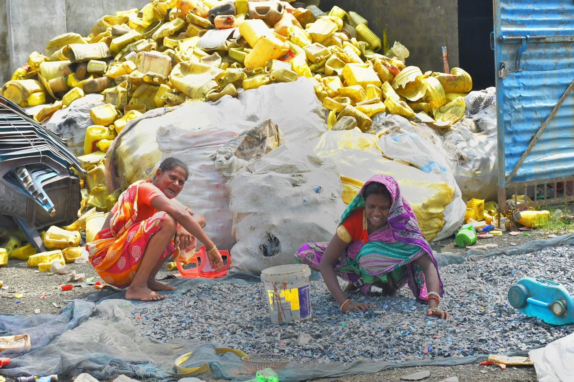 Women in Rampurhat in West Bengal, India, sort plastic waste ready for recycling, to prevent it from polluting the environment and to provide an income for their families, by Enamul Kabir