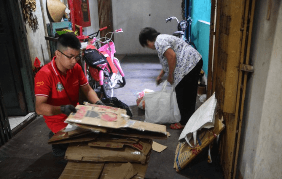 Collecting and sorting cardboard for recycling in Ho Chi Minh