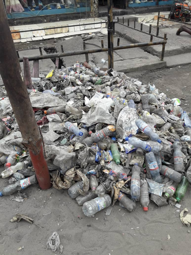 Plastic waste accumulations in the streets of Kinshasa