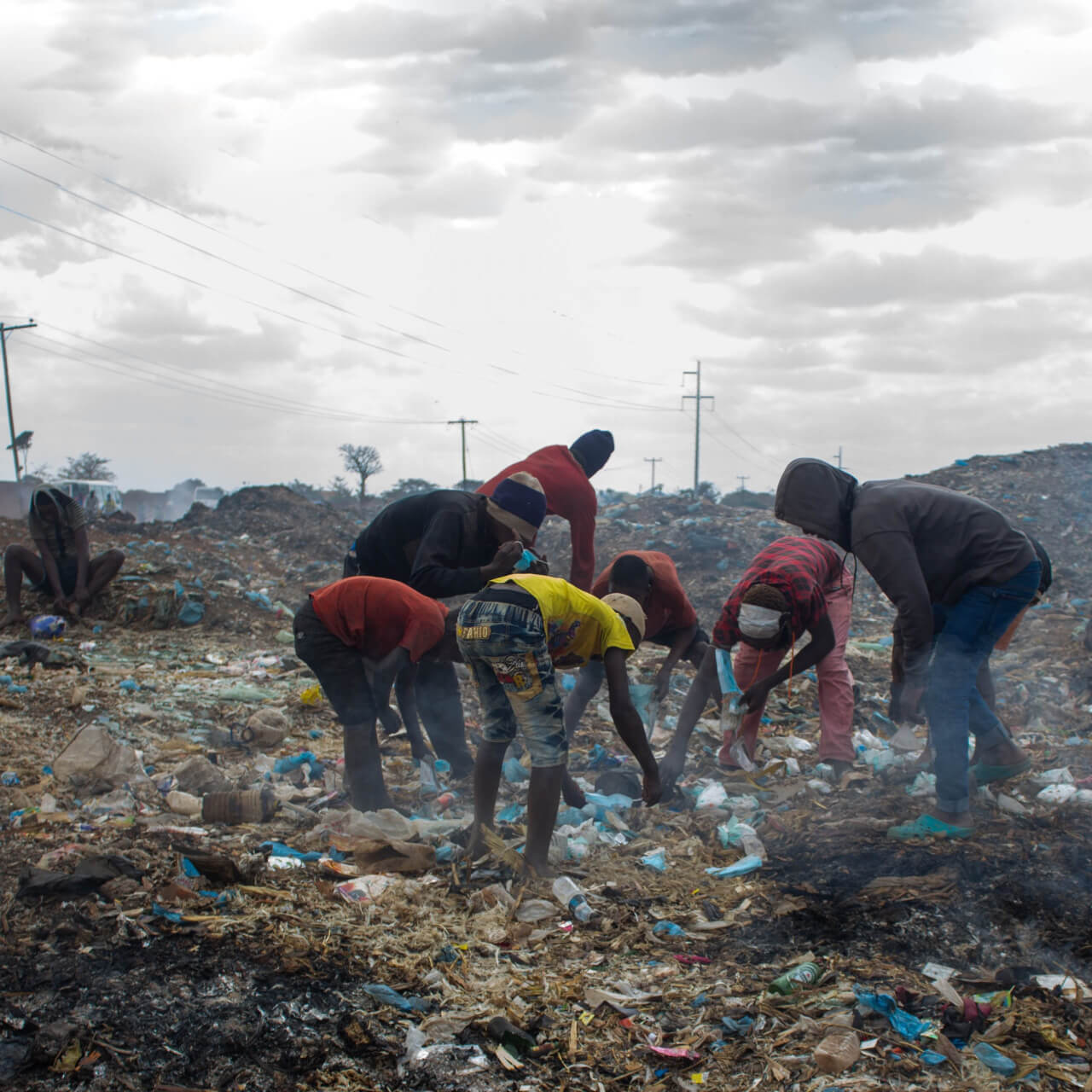 Young people picking waste from a dumpsite in Malawi