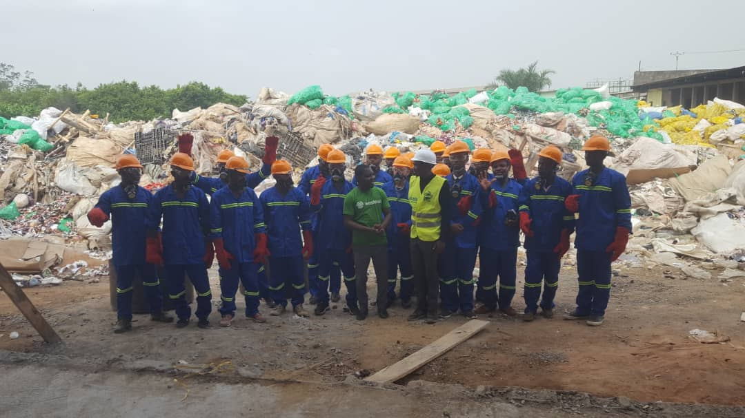 WasteAid trainees in full PPE, ready to recycle