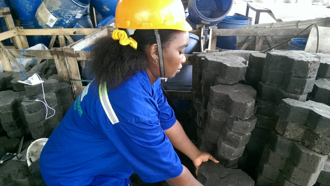 Damaris recycling plastic into paving tiles in Cameroon