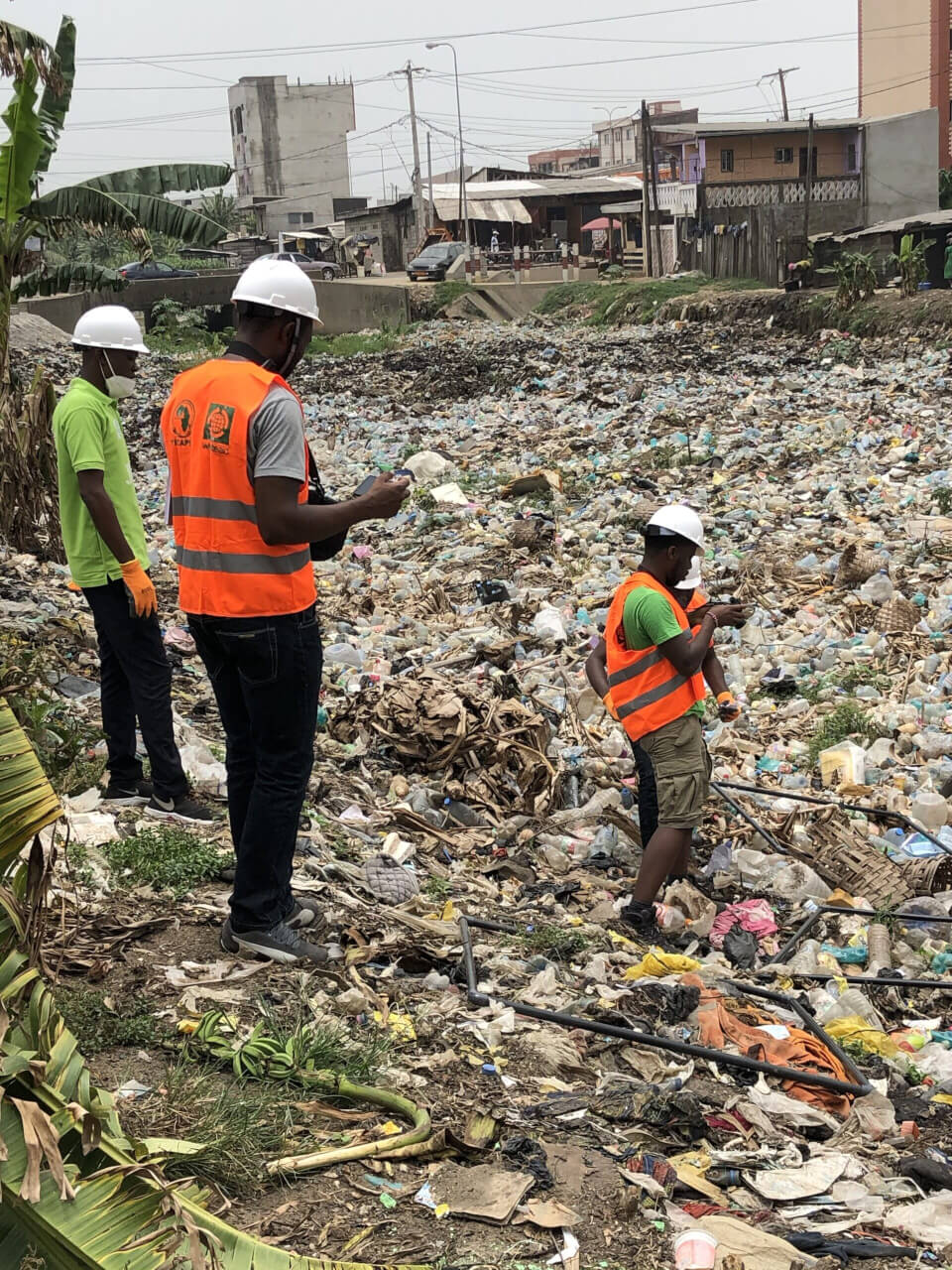 WasteAid team surveying a river full of plastic in Douala Cameroon