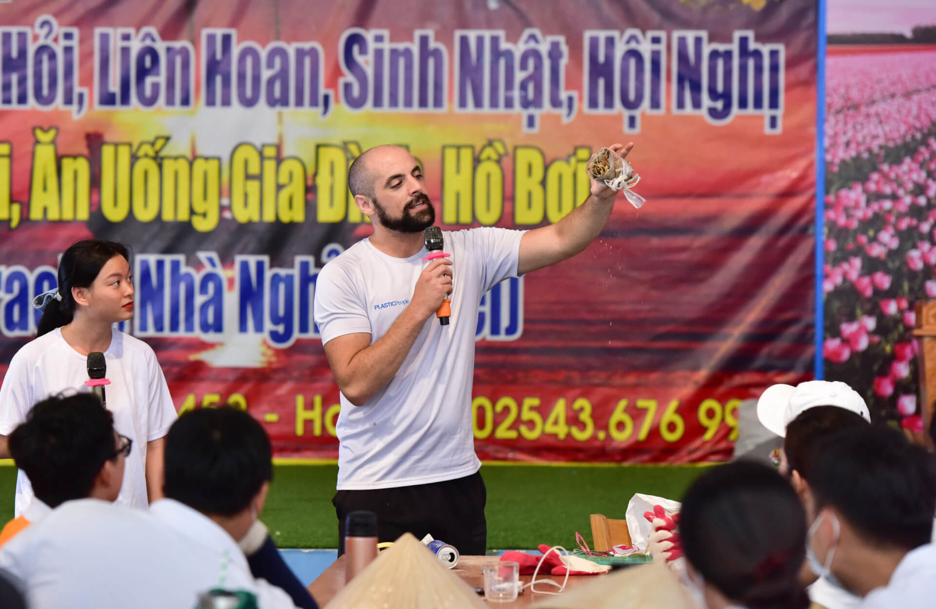 Co-founder of PLASTICPeople, Nano Morante, educating the community on single-use plastics at one network event near Ho Chi Minh in Vietnam