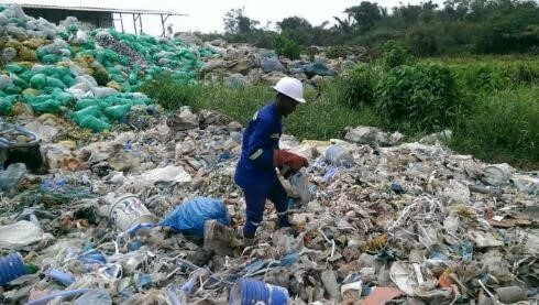 Didier sorts through plastic waste in Douala