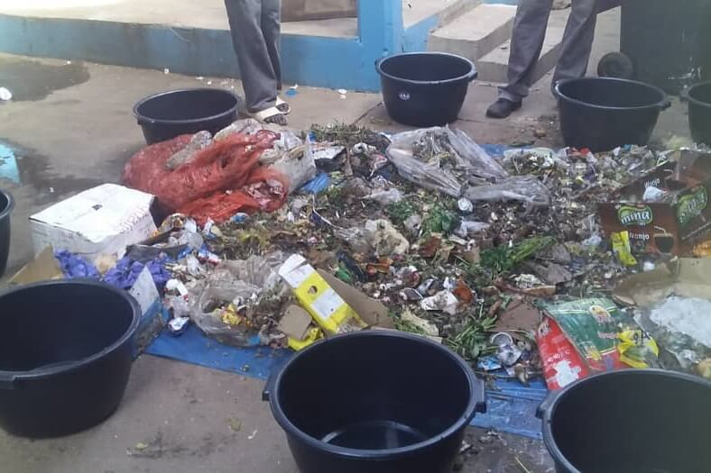 Market waste is sorted into different containers